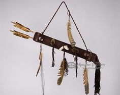 This is a Navajo made quiver with real wooden arrows. This beautiful American Indian quiver is made with genuine deer skin leather and has hand bead work at both the top and bottom of the quiver as we