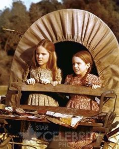 Mary and Laura in the covered wagon.