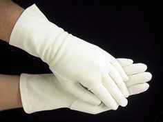 The 1950's...do not venture out without your gloves.  The outfit will not be complete without gloves!!!  Vintage hand stitched seams of soft cotton.