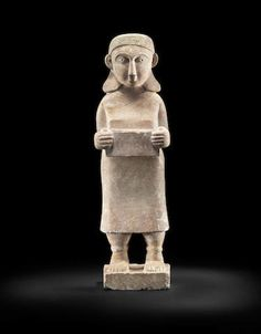 A large South Arabian gesso-painted marble female votive figure. Circa 1st Century B.C.
