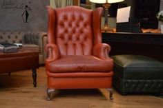 A very old orange Chesterfield wing chair, a great piece of furniture in this style.