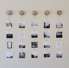 A nice option is offered on artifactuprising. If you want to create a similar display, use small wood stumps and string. Create as many rows and columns as you'd like.