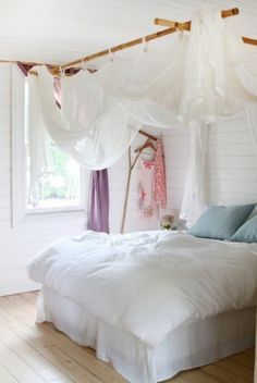 Suspend bamboo or tree branches from ceiling to create a canopy over the bed.