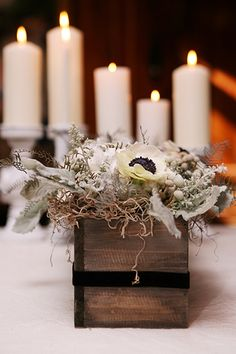 game of thrones wedding..For a homespun look, fill wooden boxes with monochromatic blooms. Cotton balls and anemones add a unique touch
