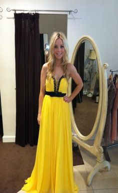 Yellow and black dress. Prom?