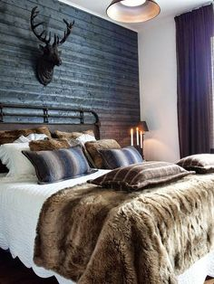 Create a comfy bedroom with a luxurious and fluffy brown fur blanket on a bed.