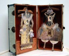 Paper constructions, Silhouettes, displayed in an old doll trunk.