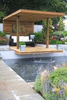 poolside wooden deck with waterfall; would make an amazing yoga space.