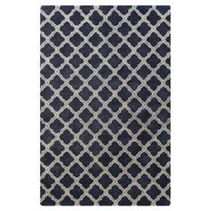 Anchor your living room seating group or define space in the den with this hand-tufted wool and art silk rug, featuring a quatrefoil-inspired trellis motif for eye-catching appeal.   Product: RugConstruction Material: Wool and art silkColor: NavyFeatures: Hand-tufted Note: Please be aware that actual colors may vary from those shown on your screen. Accent rugs may also not show the entire pattern that the corresponding area rugs have.Cleaning and Care: Regular vacuuming/spot cleaning ...