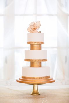 This three tiered cake with gold details is absolutely stunning! Styled by NW Event Success, photography by The Popes