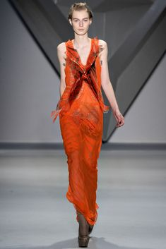 Tangerine silk chiffon crisscross appliqué V-neck gown with vault print flange detail and net lace insets over tangerine vault print techno stretch bermuda short.