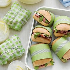 LOVE the idea of wrapping sandwiches in scrapbook paper to hold them together