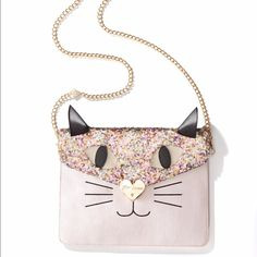 Betsey Johnson Kitty Cat Clutch/ crossbody Brand new Show off your playful side with this cat clutch embellished with sequins! Cute and functional, this accessory makes an ideal finish to any fun outfit.  • 9.5-in. W x 6-in. H x 1-in. L • Magnetic closure • Interior: 2 front slip pockets, 1 back zip pocket • Removable strap • Gold-tone hardware; self-color stitch trim Betsey Johnson Bags Clutches & Wristlets