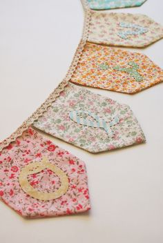 Buttons Banners love this little bunting doily bunting Family Name Banner Fabric Bunting, Bunting Garland, Bunting Banner, Garlands, Buntings, Fabric Banners, Lace Bunting, Bunting Ideas, Bunting Pattern