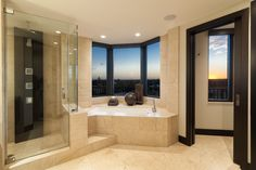 A beautiful #ModernBathroom with a stunning view. #DesignInspiration