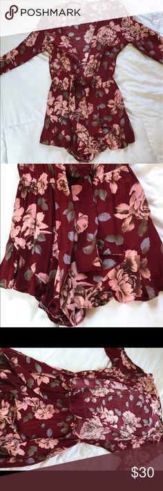 Short floral romper This romper is very short with a very low v cut in the front with a tie around the waist. It's long sleeved with ruffles on the bottom of the shorts. Cotton Candy LA Other