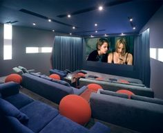 Track lighting gives your home theater a more authentic experience, while comfortable couches give plenty of seating.