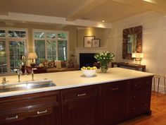 Grey Hardwood Floors Accent A Modern Kitchen With Cherry