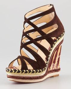 Braided jute and a batik-print heel lend a safari sensibility to this Christian Louboutin wedge. Crisscross suede straps form cage construction. Back-zip for ease of dress.
