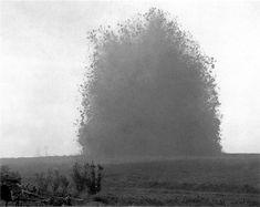 The explosion of a British mine at theHawthorn Ridge Redoubt, a German fortification in the Somme. The enormous mine contained 40,000 pounds of explosives. To get a sense of scale of the massive explosion a soldier can be seen in the very foreground on the bottom of the picture.  That day of fighting, the first day of the Battle of the Somme, would be the bloodiest day of fighting in British History.  7:20 am - July 1, 1916.
