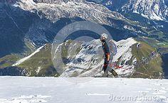 Alpinist on top of Marmolada mount - the highest peak of the Dolomite Alps
