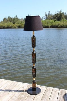 Custom handcrafted proprietary floor lamp with four wine bottles that appear to be stacked on top of each other. Customize your Custom Wine Bottles, Wine Bottle Art, Glass Bottle Crafts, Diy Bottle, Liquor Bottles, Glass Bottles, Bottle Lights, Bottle Lamps, Decoration