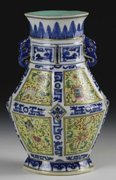 Chinese Blue and White and Famille Rose Vase, angular vase with blue and white patterns bordering densely patterned Famille Rose scenes, gilt paint along edges, mark on base. Height 10 in.