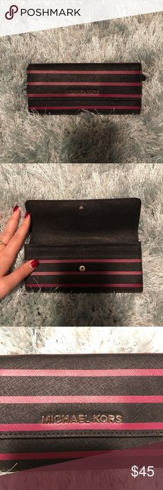 Michael Kors Wallet Slim Wallet, 8 card holders inside, zipper on back, snap closure. Like new, no blemishes. Michael Kors Bags Wallets