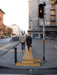 Blind path in mixed use area in Bologna #italy #social #design #brick #plastic #pavement