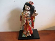 """From the A nice colorful doll with beautiful clothes! On a wooden base. She is 20 cm """") tall. Shadow Box Display Case, Acrylic Display Case, Glass Display Case, Japanese Geisha, Japanese Kimono, Vintage Japanese, Beautiful Outfits, Beautiful Clothes, Japanese Wedding"""