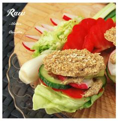 Raw einkorn bread with raw mustard and vegetables.Raw MotherDaughter
