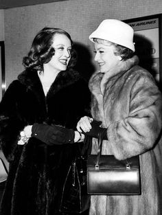 Bette Davis and Olivia de Havilland at the airport in the 1960's