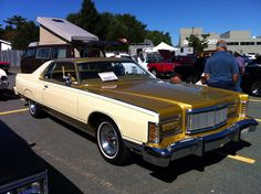 "a beautifully preserved 1977 Mercury Grand Marquis in ""Cream and Golden Glow"" two-tone paint."