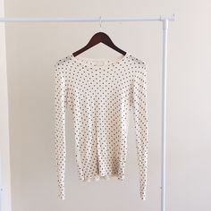 Feminine polka dot sweater Fun and flirty sweater, works well with a pencil skirt for the office or dressed down with jeans and ballet flats. In excellent condition, smoke and pet free home. Cream and black, 60% cotton, 40% rayon. Urban Outfitters Sweaters Crew & Scoop Necks