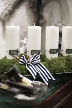 advent lighting ideas white pillar candles black white bow