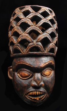 Africa | Mask of a dignitary from the Bamileke people of the Grassfields Cameroon | Wood, dark brown patina