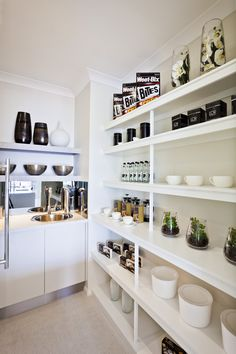 Chic butler 39 s pantry features a hicks pendant illuminating for Modern walk in pantry