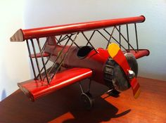 Hey, I found this really awesome Etsy listing at http://www.etsy.com/listing/163970427/biplane-tin-metal-bi-plane-airplane-art