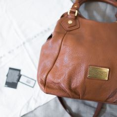 Marc by Marc Jacobs Classic Q Fran Tote Color: Cinnamon Stick. Rare color! Mint condition. No signs of wear or stains/scratches. Comes from a smoke-free environment. Includes original strap for cross body wear and dust bag. Marc by Marc Jacobs Bags Shoulder Bags