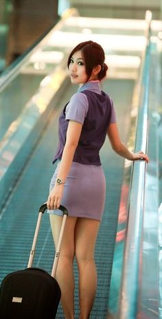 Being escorted, hands bound behind my back, by the stewardess who restrained me…