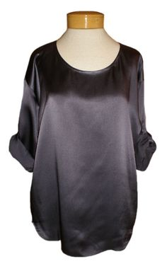 "Eileen Fisher Hammered Silk Satin Ballet Neck Top    We are totally crazy for this lovely silk top in a ""Twilight"", a rich indigo that goes with so many things. A perfect scoop neck and tabbed sleeves look feminine and easy, and the fit is luxurious and flattering. A gorgeous drape to the thigh, this top looks amazing with sexy black pants, or leggings, or layered with sassy denim. A wonderful holiday top waiting to be dressed up or down!"