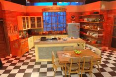 Rachel Ray's kitchen set -- love the orange, and the fridge.