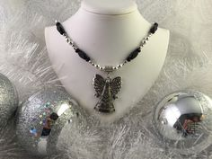 A personal favorite from my Etsy shop https://www.etsy.com/listing/256301581/christmas-angel-necklace-silver-with