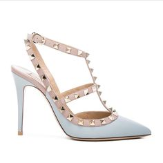 Valentino Leather Slingbacks T.100 in Sky Sorbet ~ABSOLUTELY NO TRADE~ Leather upper and sole. Made in Italy. Approximately 100mm/4 inch heel. Ankle strap with buckle closure. Metallic pyramid stud detail throughout. Original shoe box, two extra studs, two extra shoe soles, original dust bag, and authentic card all included. Valentino Shoes Heels