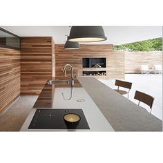 Sleek   via @customhomes #interiordesign #chicliving #designinspo #architecture #timber #kitchen #design #kitcheninspo #modernkitchens #luxeliving #modernhouses by branwhiteandingramdesigns Great design ideas for a modern kitchen remodel.