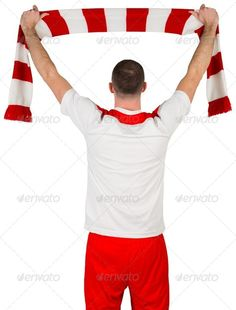 Football player holding striped scarf on white background ...  20s, activity, attractive, caucasian, cheering, cut out, euphoria, excited, football, gear, handsome, holding, isolated, male, man, player, red, scarf, soccer, sport, sportsman, sportswear, waving, white, win, winner, winning, young adult