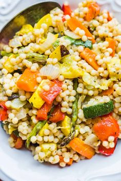Pearl Couscous with Roasted Vegetables is a healthy alternative to traditional pasta salads. Tossed with roasted veggies, this side dish is full of flavor. Vegetable Recipes, Vegetarian Recipes, Cooking Recipes, Healthy Recipes, Vegetable Side Dishes, Grilling Recipes, Roasted Vegetable Salad, Roasted Vegetables, Pearl Couscous Recipes