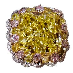 Magnificent 20.70 Ct Fancy Intense Yellow Ring  USA  21st Century  The center diamond is 20.70 CT. Fancy Intense Yellow.  GIA CERTIFIED.  Surrounded by Fancy pink and Yellow Diamonds