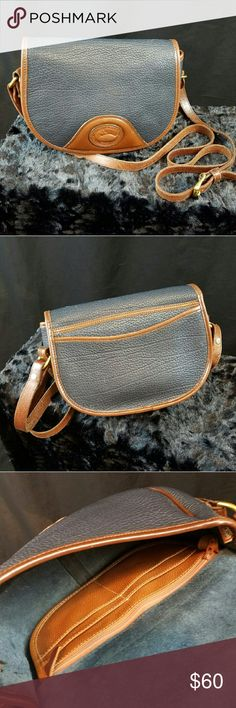 """Dooney & Bourke Vintage Navy Blue Crossbody bag Vintage Dooney & Bourke all-weather duck crossbody bag. 22""""-26"""" adjustable strap. In good pre-loved condition. No major scuffs or scratches (closeups and other angles furnished upon request). Approximately 10"""" wide, 7"""" tall, 4"""" wide at its widest point. Dooney & Bourke Bags Crossbody Bags"""
