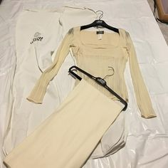 Versace Top and pants Top has sheer sleeves and stomach with double lay chest. Pants are cream. Size 40 for both top and bottom Versace Tops